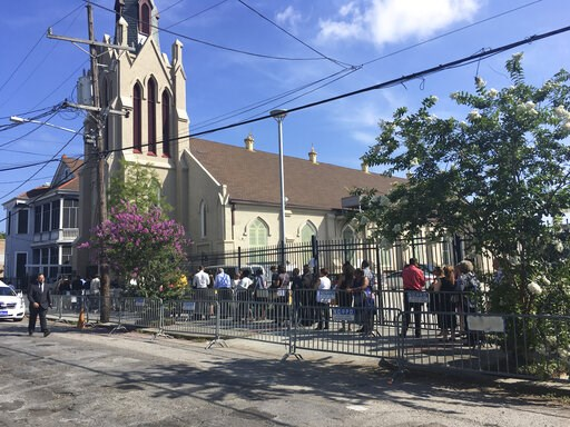 (AP Photo/Kevin McGill). Admirers line up outside St. Peter Claver Catholic Church in New Orleans on Monday, June 10, 2019, to pay last respects to famed New Orleans chef Leah Chase, who died June 1.