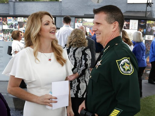 (AP Photo/John Raoux). Barbara Poma, left, CEO of the onePulse foundation, talks with Orange County Sheriff John Mina before a news conference to introduce legislation that would designate the Pulse nightclub site as a national memorial, Monday, June 1...