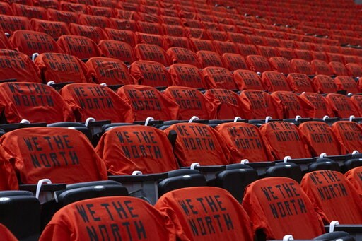 (Chris Young/The Canadian Press via AP). Tee shirts are shown on seats at Scotiabank Arena before Game 5 of the NBA Finals between the Golden State Warriors and Toronto Raptors in Toronto, Monday, June 10, 2019.