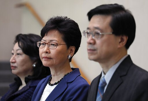(AP Photo/Vincent Yu). Hong Kong Secretary for Security John Lee, right,  Hong Kong Chief Executive Carrie Lam, center, and Secretary of Justice Teresa Cheng listen to reporters questions during a press conference in Hong Kong Monday, June 10, 2019. La...