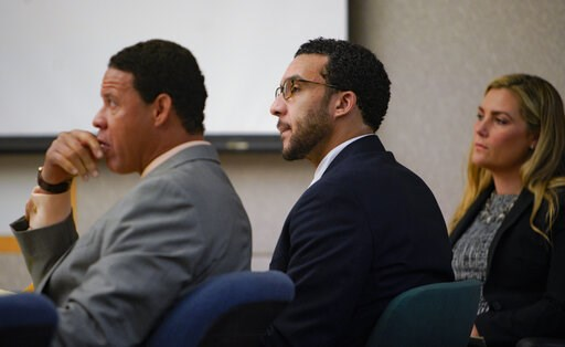 (Nelvin C. Cepeda/The San Diego Union-Tribune via AP, Pool). Sitting in Superior Court in Vista, Kellen Winslow, Jr., is flanked by two of his three defense attorneys, Brian Watkins, left, and Elizabeth Bahr, right, as he listens to closing arguments t...