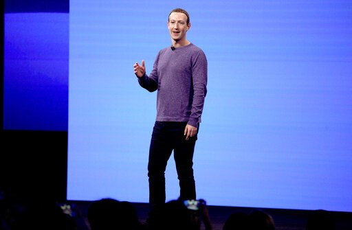 (AP Photo/Tony Avelar, File). FILE - In this April 30, 2019, file photo, Facebook CEO Mark Zuckerberg makes the keynote speech at F8, Facebook's developer conference in San Jose, Calif. The Boston-based renewable energy developer Longroad Energy announ...