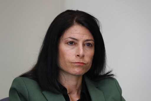 (AP Photo/Paul Sancya). In this June 4, 2019, photo, Dana Nessel, Attorney General of Michigan, listens to a question from reporters in Detroit. Hundreds of boxes. Millions of records. From Texas to Michigan this month, attorneys general are sifting th...
