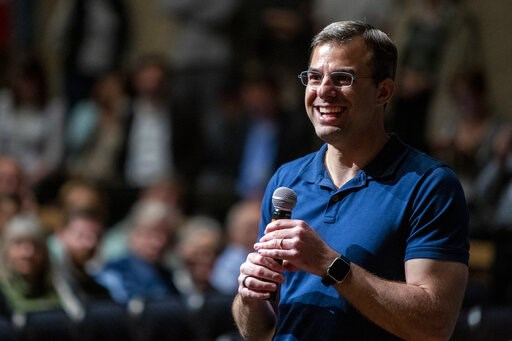 (Cory Morse/The Grand Rapids Press via AP). U.S. Rep. Justin Amash, R-Cascade Township, holds a town hall meeting at Grand Rapids Christian High School's DeVos Center for Arts and Worship on Tuesday, May 28, 2019. The congressman came under scrutiny Ma...