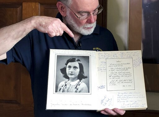 (AP Photo/Philip Marcelo). In this June 7, 2019 photo, Ryan Cooper holds a 1972 portion of a diary that he wrote when he visited Otto Frank, the father of the famed Holocaust victim and diarist Anne Frank, at his home in Yarmouth, Mass. The diary inclu...