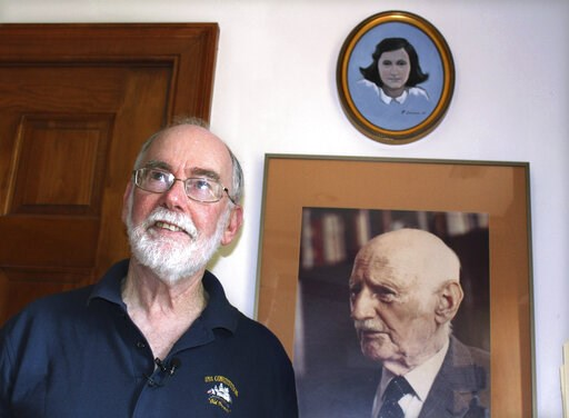 (AP Photo/Philip Marcelo). In this June 7, 2019 photo, Ryan Cooper stands next to a photo of Otto Frank, the father of the famed Holocaust victim and diarist Anne Frank, at his home in Yarmouth, Mass. Above the photo is a painting of Anne Frank by Coop...