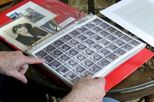 (AP Photo/Philip Marcelo). In this June 7, 2019 photo, Ryan Cooper shows photos of Anne Frank that he kept in a scrapbook at his home in Yarmouth, Mass. The 48 small images were made in a photo booth in 1940. Cooper has donated a trove of letters and m...
