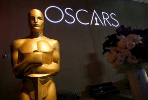(Photo by Danny Moloshok/Invision/AP, file). FILE - In this Feb. 4, 2019 file photo, the Oscar statue appears the 91st Academy Awards Nominees Luncheon at The Beverly Hilton Hotel in Beverly Hills, Calif.  The Academy of Motion Picture Arts and Science...