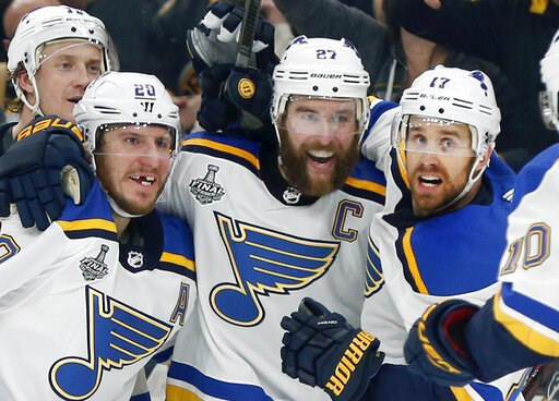 (AP Photo/Michael Dwyer). St. Louis Blues' Alex Pietrangelo, second from right, celebrates his goal with teammates Jay Bouwmeester, left rear, Alexander Steen, left, and Jaden Schwartz, right, during the first period in Game 7 of the NHL hockey Stanley...