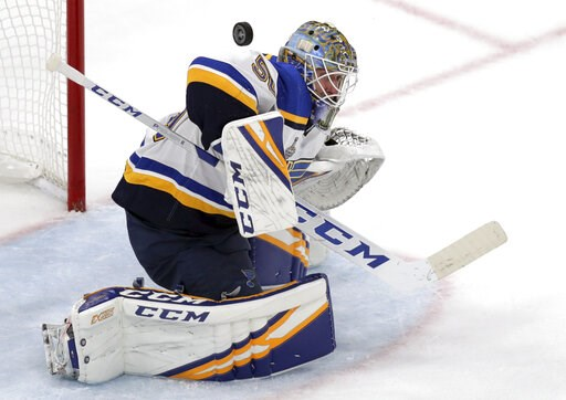 (AP Photo/Charles Krupa). St. Louis Blues goaltender Jordan Binnington turns a shot away during the second period in Game 7 of the NHL hockey Stanley Cup Final against the Boston Bruins, Wednesday, June 12, 2019, in Boston.