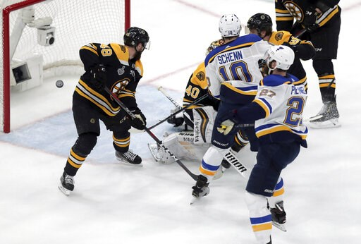 (AP Photo/Charles Krupa). St. Louis Blues' Alex Pietrangelo, right, watches his shot sail into the net behind Boston Bruins goaltender Tuukka Rask (40), of Finland, and Matt Grzelcyk (48) during the first period in Game 7 of the NHL hockey Stanley Cup ...