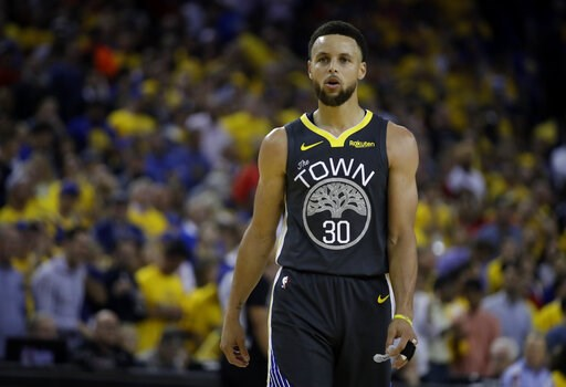 (AP Photo/Ben Margot). Golden State Warriors' Stephen Curry walks on the court during a timeout in the second quarter of Game 6 of basketball's NBA Finals against the Toronto Raptors Thursday, June 13, 2019, in Oakland, Calif.