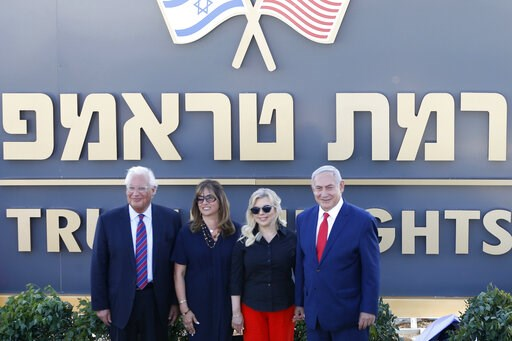 (AP Photo/Ariel Schalit). Israeli Prime Minister Benjamin Netanyahu, right, his wife Sara , United States Ambassador to Israel David Friedman, left, his wife Tammy pose during the inauguration of a new settlement named after President Donald Trump in t...