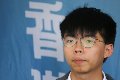 (AP Photo/Kin Cheung, File). FILE - In this May 16, 2019, file photo, Pro-democracy activist Joshua Wong speaks to media at a court in Hong Kong. Members of his Demosisto party say the Hong Kong activist Wong, a leading figure in the 2014 Umbrella Move...