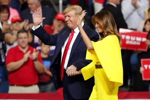 President Donald Trump and first lady Melania Trump greet supporters at a rally where the president formally announced his 2020 re-election bid Tuesday, June 18, 2019, in Orlando, Fla. (AP Photo/John Raoux)