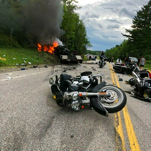 (Miranda Thompson via AP). This photo provided by Miranda Thompson shows the scene where several motorcycles and a pickup truck collided on a rural, two-lane highway Friday, June 21, 2019 in Randolph, N.H.  New Hampshire State Police said a 2016 Dodge ...