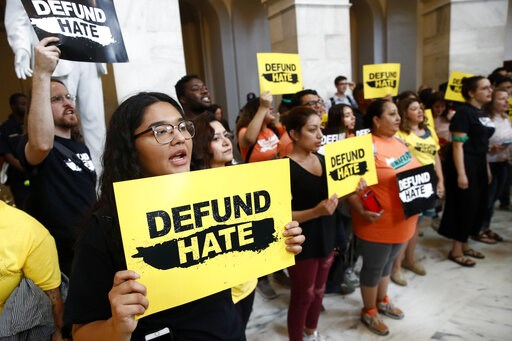 (AP Photo/Patrick Semansky). Protesters gather to demand the defunding of government agencies for border protection and customs enforcement, Tuesday, June 25, 2019, on Capitol Hill in Washington.