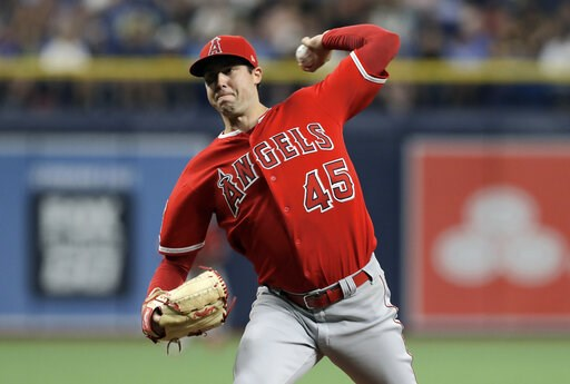 (AP Photo/Chris O'Meara, file). FILE - In this June 13, 2019 file photo Los Angeles Angels' Tyler Skaggs pitches to the Tampa Bay Rays during the first inning of a baseball game in St. Petersburg, Fla. Tyler Skaggs has died at age 27, Monday, July 1, 2...