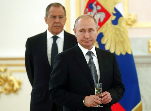 (Maxim Shipenkov/Pool Photo via AP). Russian President Vladimir Putin, center, and Russian Foreign Minister Sergei Lavrov attend a ceremony to receive credentials from newly appointed foreign ambassadors to Russia in Kremlin, Moscow, Russia, Wednesday,...