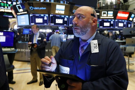 (AP Photo/Richard Drew, File). FILE - In this July 1, 2019, file photo trader Vincent Napolitano works on the floor of the New York Stock Exchange. The U.S. stock market opens at 9:30 a.m. EDT on Wednesday, July 3.