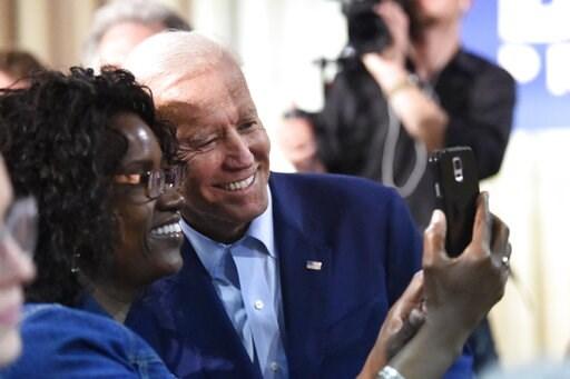 (AP Photo/Meg Kinnard). Former Vice President Joe Biden takes selfie photos with supporters after a speech on Saturday, July 6, 2019, in Orangeburg, S.C.