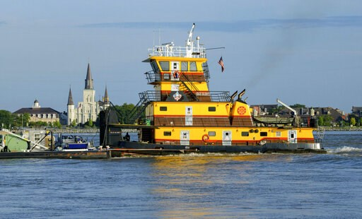 (AP Photo/Matthew Hinton). The Old Glory towing vessel appears taller than St. Louis Cathedral in the French Quarter as the Mississippi River is currently above 16 feet, which is just below flood stage at 17 feet, in New Orleans, Thursday, July 11, 201...