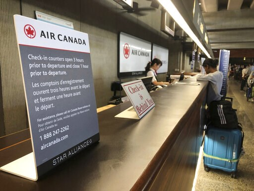 (AP Photo/Caleb Jones). Passengers from an Australia-bound Air Canada flight diverted to Honolulu Thursday, July 11, 2019, after about 35 people were injured during turbulence, stand in line at the Air Canada counter at Daniel K. Inouye International A...