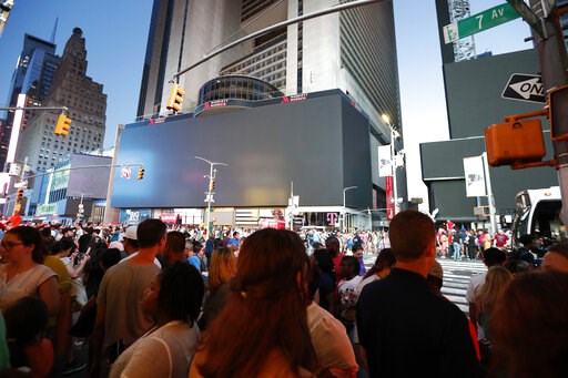 (AP Photo/Michael Owens). Screens in Times Square are black during a widespread power outage, Saturday, July 13, 2019, in the Manhattan borough of New York. Authorities say a transformer fire caused a power outage in Manhattan and left businesses witho...
