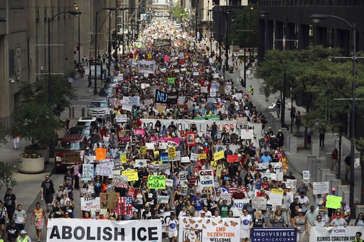 (Abel Uribe/Chicago Tribune via AP). Thousands of people, including immigrants and their supporters, rally against President Trump's immigration policies as they march from Daley Plaza to the Chicago field office of Immigration and Customs Enforcement,...