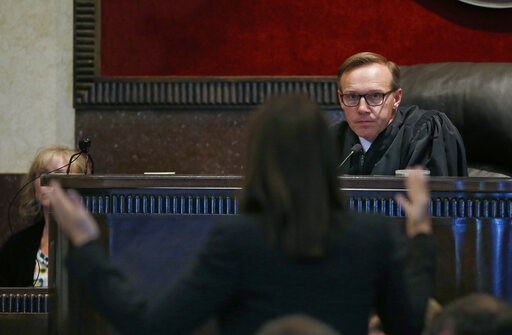 Judge Thad Balkman listens to a defense attorney during the last day of testimony in Oklahoma's ongoing opioid drug lawsuit against Johnson & Johnson Friday, July 12, 2019, in Norman, Okla.  (AP Photo/Sue Ogrocki, Pool)