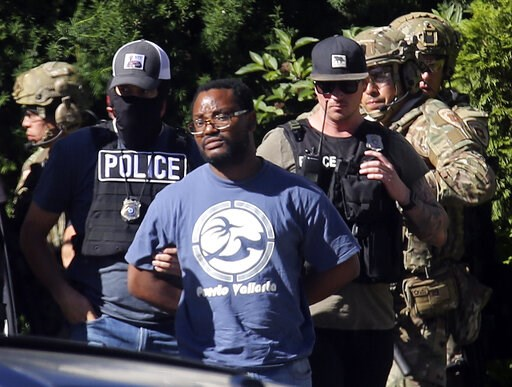 (Kristin Murphy/The Deseret News via AP, File). FILE - In this June 28, 2019, file photo, Salt Lake City police take Ayoola A. Ajayi into custody in connection with missing University of Utah student MacKenzie Lueck in Salt Lake City.  Ajayi, has been ...