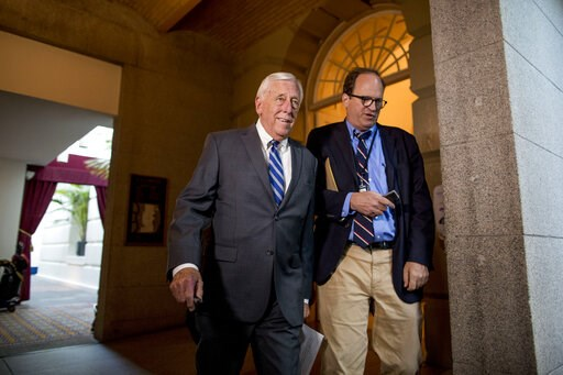 (AP Photo/Andrew Harnik). House Majority Leader Steny Hoyer of Md., left, arrives for a House Democratic caucus meeting on Capitol Hill in Washington, Wednesday, July 10, 2019.