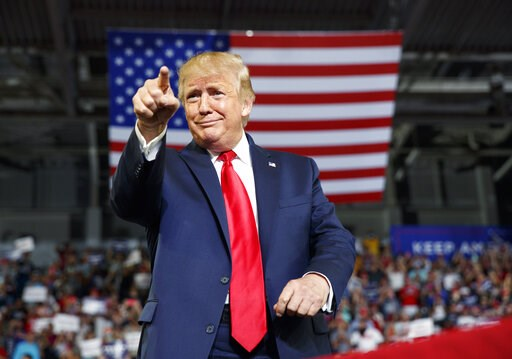 (AP Photo/Carolyn Kaster). President Donald Trump gestures to the crowd as he arrives to speak at a campaign rally at Williams Arena in Greenville, N.C., Wednesday, July 17, 2019.