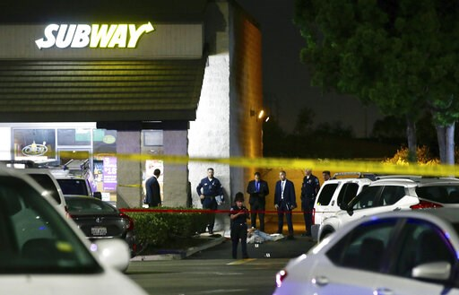 (AP Photo/Alex Gallardo). EDS NOTE: GRAPHIC CONTENT - Police work the scene of a stabbing in Santa Ana, Calif., Wednesday, Aug. 7, 2019. A man killed multiple people and wounded others in a string of robberies and stabbings in California's Orange Count...