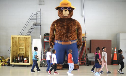 A giant Smokey Bear statue greets children at a fire station in Kinston, N.C., on October 11, 2017. (Janet S. Carter/Daily Free Press via AP)