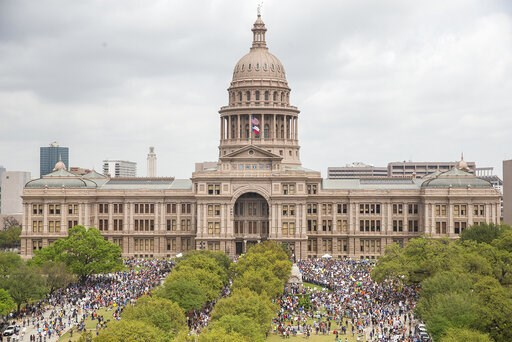 "(Nick Wagner/Austin American-Statesman via AP, File). FILE - In this March 24, 2018, file photo, thousands of people gather on the grounds of the Texas State Capitol during a ""March for Our Lives"" rally in Austin, Texas. After dozens of people, includi..."
