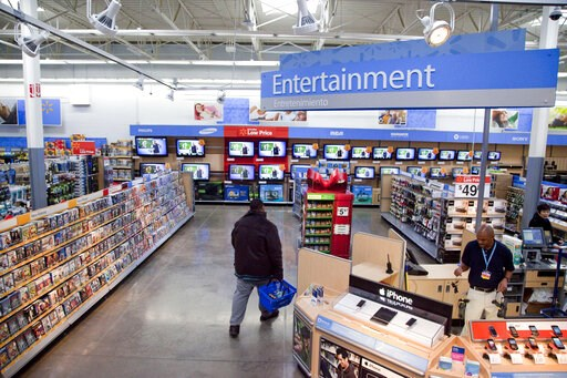(AP Photo, File). FILE = In this Dec. 15, 2010 file photo, a view of the entertainment section of a Wal-Mart store is seen in Alexandria, Va.  Walmart is taking down all signs and displays from its stores that depict violence, following a mass shooting...