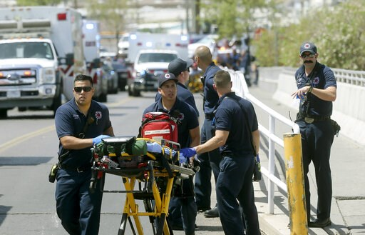 (Mark Lambie/The El Paso Times via AP, File). FILE - In this Aug. 3, 2019 file photo, El Paso Fire Medical personnel arrive at the scene of a shooting at a Walmart near the Cielo Vista Mall in El Paso, Texas. The FBI has labeled two of those attacks, a...