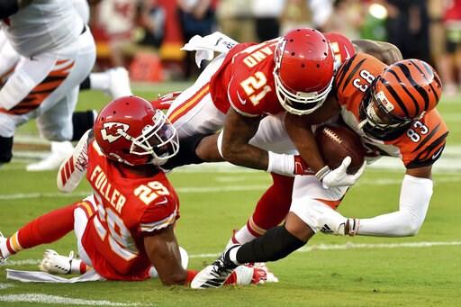 (AP Photo/Ed Zurga). Cincinnati Bengals wide receiver Tyler Boyd (83) is tackled by Kansas City Chiefs cornerback Bashaud Breeland (21) and cornerback Kendall Fuller (29) during the first half of an NFL preseason football game in Kansas City, Mo., Satu...