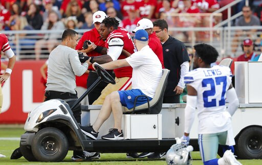(AP Photo/Josie Lepe). San Francisco 49ers offensive tackle Shon Coleman, center left, is helped onto a cart during the first half of the team's NFL preseason football game against the Dallas Cowboys in Santa Clara, Calif., Saturday, Aug. 10, 2019.