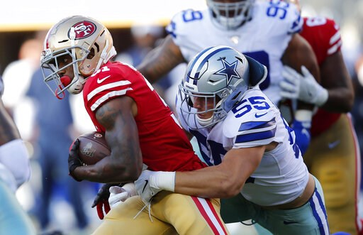 (AP Photo/John Hefti). San Francisco 49ers running back Raheem Mostert, left, tries to get away from Dallas Cowboys linebacker Leighton Vander Esch (55) during the first half of an NFL preseason football game in Santa Clara, Calif., Saturday, Aug. 10, ...