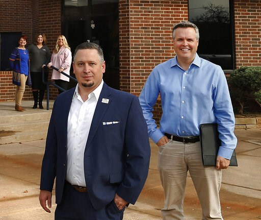 (Photo by Jim Beckel, The Oklahoman via AP). This Nov. 1, 2018 photo shows Epic Charter Schools Superintendent David Chaney, left, and founder Ben Harris, right in Oklahoma City, Oka.  An investigation into the founders of an online charter school in O...