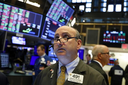 (AP Photo/Richard Drew, File). FILE - In this Tuesday, Aug. 13, 2019, file photo trader Andrew Silverman works on the floor of the New York Stock Exchange. The threat of a recession doesn't seem so remote anymore, and stocks sank Wednesday after the bo...