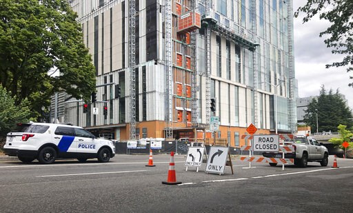 (AP Photo/Gillian Flaccus). A road closure sign is seen in downtown Portland, Ore., Friday, Aug. 16, 2019, in advance of a rally as the city prepares for crowds. In the past week, authorities in Portland have arrested a half-dozen members of right-wing...