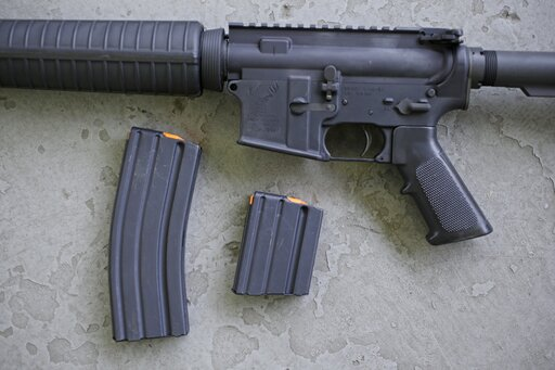 (AP Photo/Charles Krupa, File). FILE - In this April 10, 2013, file photo, a stag arms AR-15 rifle with 30 round, left, and 10 round magazines is displayed in New Britain, Conn. High-capacity magazines have been a common denominator in several mass kil...
