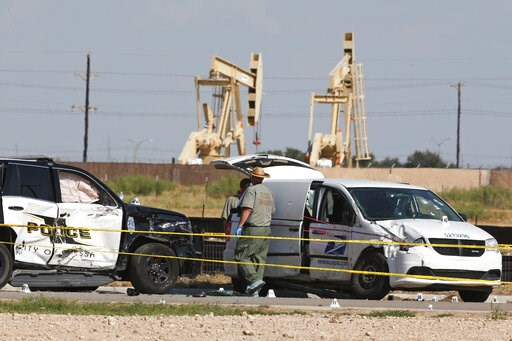 (AP Photo/Sue Ogrocki). Law enforcement officials process the crime scene Sunday, Sept. 1, 2019, in Odessa, Texas, from Saturday's shooting which ended with the alleged shooter being shot dead by police in a stolen mail van, right.