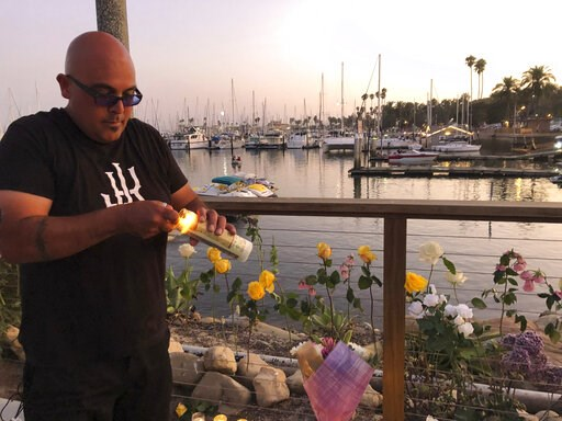 (AP Photo/Stefanie Dazio). Orlando Aldana, 42, of Santa Barbara, bought 34 candles in honor of the victims to place at the growing memorial for those caught in the fire on the Conception boat, Monday, Sept. 2, 2019, in Santa Barbara, Calif. A fire rage...