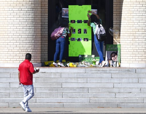 (Ronald W. Erdrich/The Abilene Reporter-News via AP). Students write their thoughts on a memorial for Leilah Hernandez on the front steps of Odessa High School, Tuesday Sept. 3, 2019. in Odessa, Texas. The 15 year-old student was the youngest of seven ...