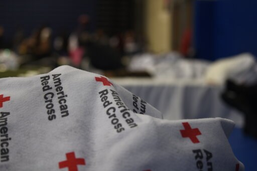 (AP Photo/Meg Kinnard). An evacuee rests on a cot in an American Red Cross shelter at R.B. Stall High School on Wednesday, Sept. 4, 2019, in North Charleston, S.C. Officials estimate around 300 people have sought shelter here as Hurricane Dorian approa...
