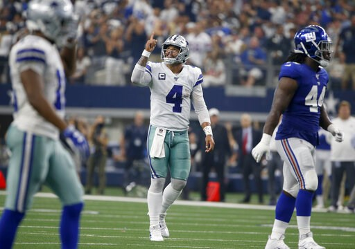 (AP Photo/Ron Jenkins). Dallas Cowboys' Dak Prescott (4) celebrates a touchdown as New York Giants linebacker Markus Golden (44) walks away in the first half of a NFL football game in Arlington, Texas, Sunday, Sept. 8, 2019.